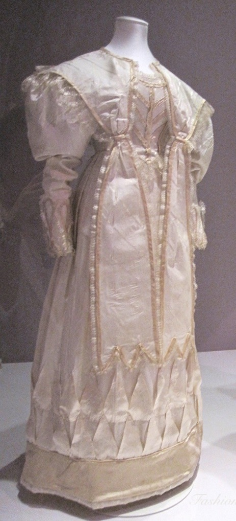 1828 Silk trimmed with silk satin and bobbin lace, lined in cotton worn by Eliza Larken when she married William (Victoria and Albert Museum - London, UK) From fashionablylateagain.blogspot.com/2012/09/the-wedding-dress-200-years-of-wedding.html