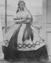 1863-1864 Isabella Grace, in fancy dress (Spanish), eyes down, standing, arms akimbo by Clementina, Lady Hawarden (Victoria and Albert Museum - London, UK) detint X 2 all 4 corners fixed