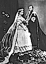 1863 Alice and Louis in garter robes at Prince of Wales' wedding