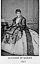 1863 Duchesse de Morny wearing a Worth crinoline day dress
