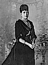 1893 Alexandra wearing a vee-neckline dress by Lafayette