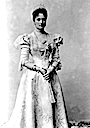 1898 Tsaritsa Alexandra in dress with spyglass sleeves standing
