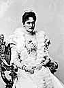 1898 Tsaritsa Alexandra in dress with spyglass sleeves sitting