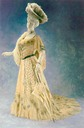 1900 Worth dinner gown machine alençon lace over white satin with Venetian glass beads irridescent pailletes in blue