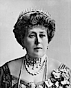 1911 Beatrice wearing sun ray and Greek key tiara from front