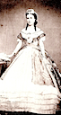 Carlota in later 1860s evening gown