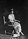 Charlotte seated wearing a tiara