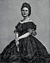 Empress Carlota wearing dark dress