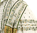 Dress and wrap, brought to Vienna as part of her trousseau, embroidered with Hebrew print closeup