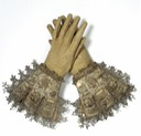 Leather, satin and embroidered and lace trimmed early 17th century gloves