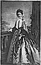 Maria Pia wearing a dress with flared sleeves