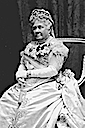 Older Infanta Isabel seated at formal occasion