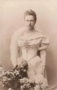 Queen Olga wearing a simple evening dress