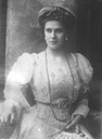 Princess Alice of Greece seated wearing a dark necklace