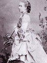 Princess Helena wearing a bustle carrying a parasol