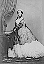 Princess Alexandra wearing a crinoline dress and lace shawl