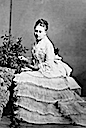 Princess Beatrice wearing a crinoline era dress