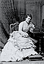 ca. 1875 Princess Helena wearing a bustle dress seated with fan by Bassano