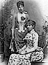 Princess Louise (standing) and her sister Crownprincess Stéphanie of Austria wearing bustle dresses