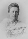 Closeup of Queen Olga wearing a simple evening dress