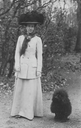 Queen Victoria of Sweden and her poodle post card