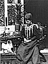 Queen Alexandra looking at a dog