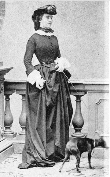 Sissi Wearing An Equestrian Dress With A Small Dog Grand