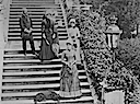 Stéphanie with Gräfin Tarouca, Resi Pálffy, Sidonie Chotek, and Graf Charly Bombelles on the stairs of Miramare