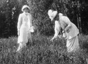 Tatiana and Alexandra picking flowers (Romanov Collection, General Collection, Beinecke Rare Book and Manuscript Library, Yale University - New Haven, Connecticut USA)